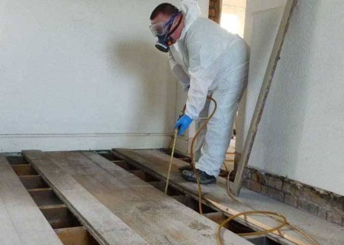 timber-treatment-being-performed-on-floor-boards